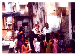 Distributing milk in Calcutta's Homoeopathic Charity