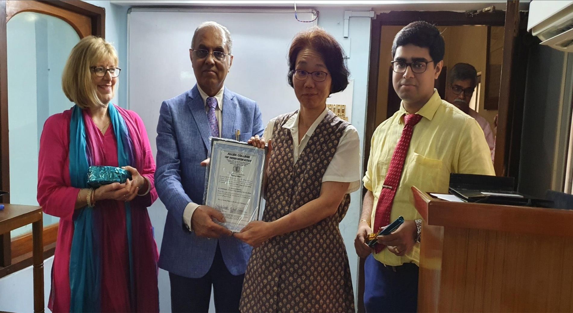 Certificate awarding at the end of the programme Reiko, Allen College, Japan Co ordinator who return