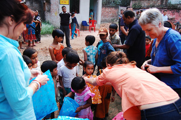 Students distributing clothes after the clinic