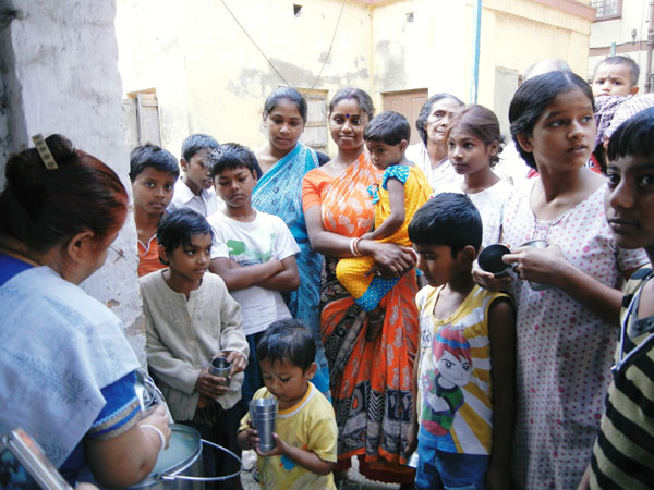 Dr. Medha Bhatt with waiting patients