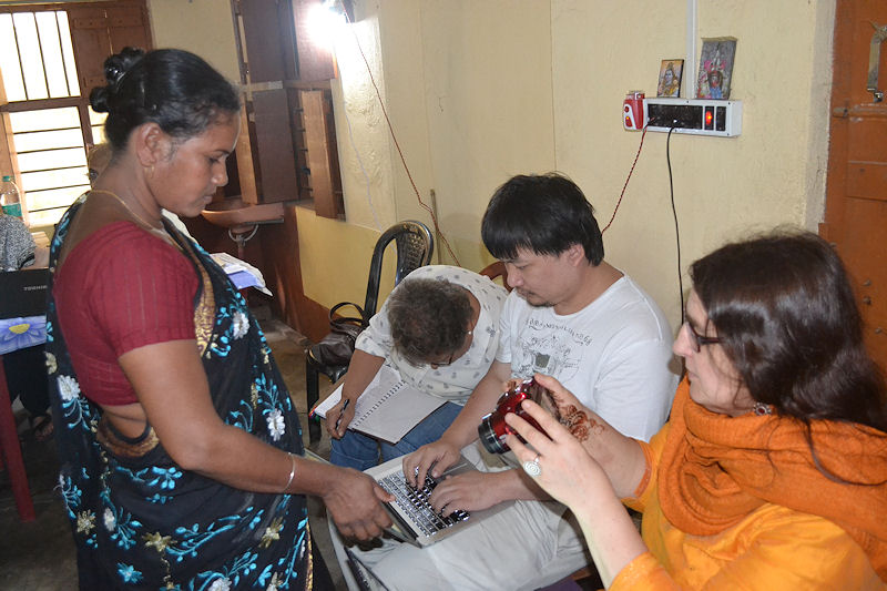 Overseas participants having a closer examination of the patient