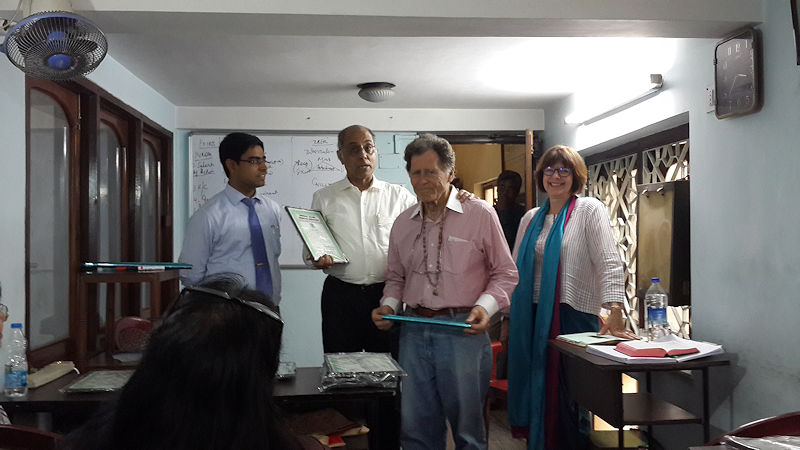 Dr Karl Robinson, MD, a senior homoeopath from USA receiving his Certificate at the end of the cours