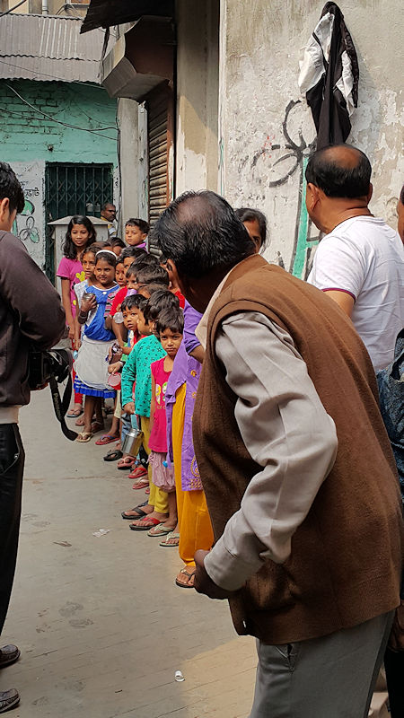 Slum Clinic Calcutta - Children queing for Milk & Medicine