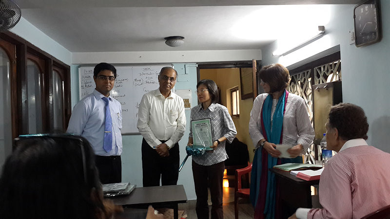 Thailand Doctor receiving her Certificate at the end of the Course