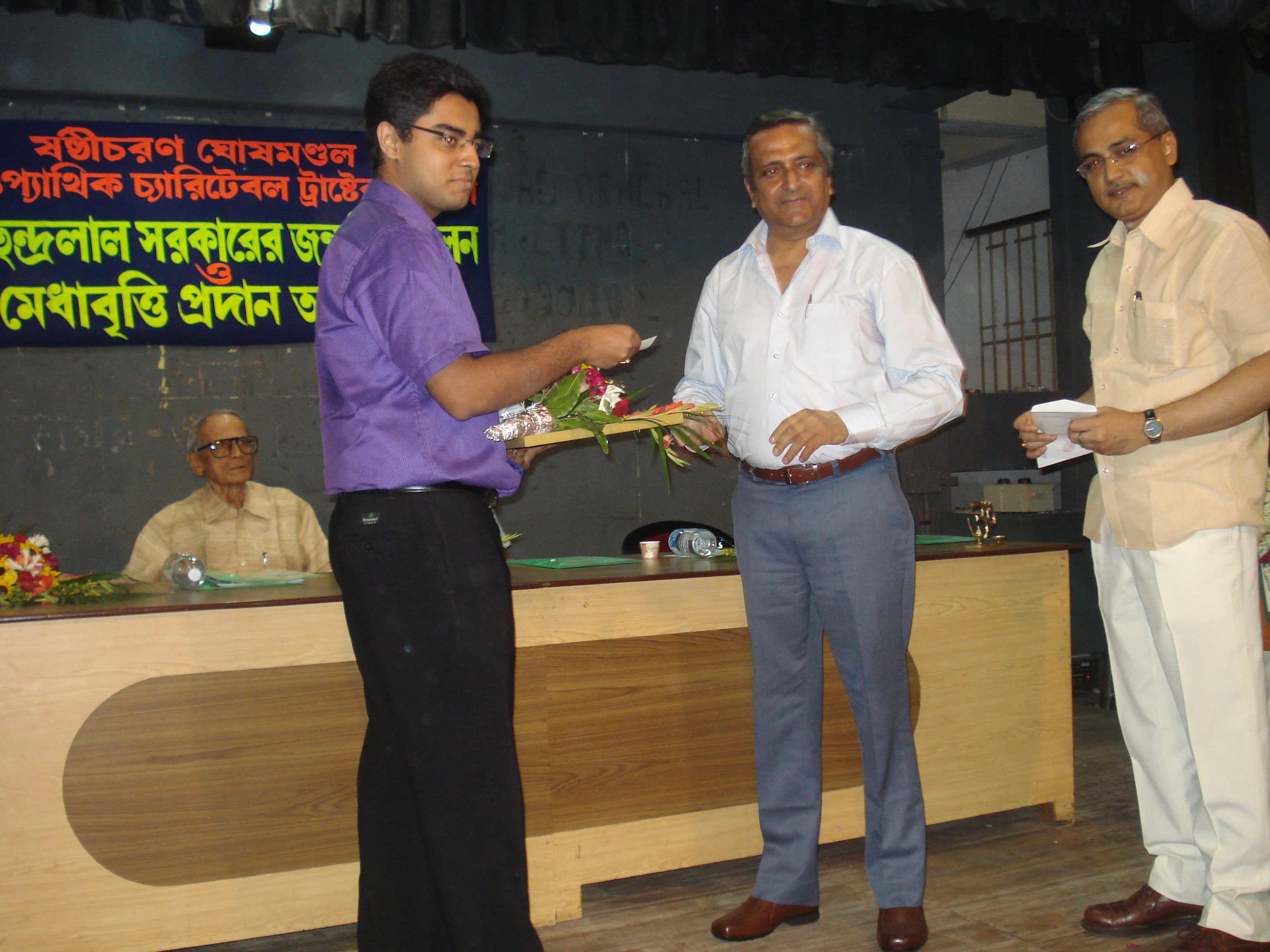 Dr.Saptarshi being honoured with the S.C.G.M Award for 1st position in the University.