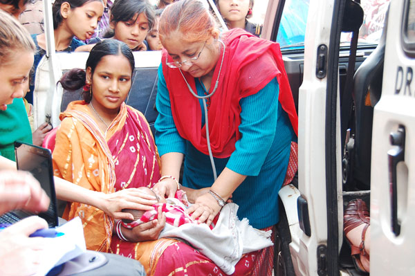 Dr. Bhatt in the Slum with the Mobile Medical Van.